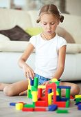 Child playing with blocks at home