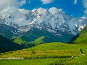 Beautiful meadow landscape near Ushguli, Svaneti, Georgia. Shkhara mountain in the background