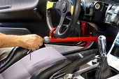 foto of theft  - Hand locking anti-theft device on car