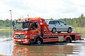Tow Truck Rescuing Car From Flood