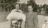 LODZ, POLAND,CIRCA FIFTIES- vintage photo of godparents with a baby in traditional baby's sleeping bag for christening, Lodz, Poland, circa fifties