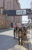 DUBLIN, IRELAND - JUNE 7: Horse drawn carriages wait for tourists in front of Guinness Storehouse, D