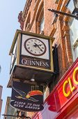 DUBLIN, IRELAND - JUNE 7: Clock with Guinness logo on a building, Dublin, Ireland on June 7, 2013