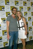 SAN DIEGO, CA - JULY 20: Kris Holden-Ried and Zoie Palmer arrives at the 2013 Comic Con press room a