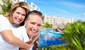 Happy senior couple at tropical resort. Caribbean vacation.