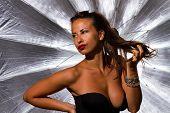 beautiful girl in photo studio silver umbrella in background