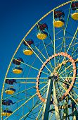 Ferris Wheel On Blue Sky In Amusement Park