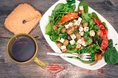 Dish Of Baby Spinach Salad With Bread And Tea