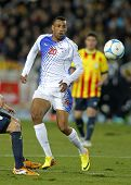 BARCELONA - DEC, 30: Cape Verdean player Carlos Lima Calu in action during the friendly match between Catalonia and Cape Verde at Olympic Stadium on December 30, 2013 in Barcelona, Spain