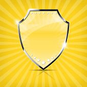 Glossy security shield on yellow background