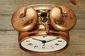 Old-fashioned Vintage Copper Alarm Clock