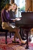 Mother and daughter piano duet