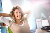 Woman relaxing in office chair
