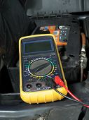Multimeter set up and ready for taking car battery voltage measurement