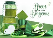 Bright Colorful Green Theme Gift Wrapping With Ribbons, Bows, Gift Tags, Scissors, And Wrapping Pape
