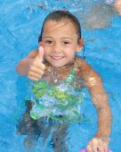 "Little Girl giving the ""Thumbs Up"" sign in the Swimming Pool"