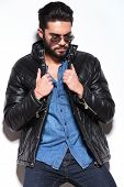 foto of down jacket  - sad man in leather jacket and sunglasses looking down in studio - JPG