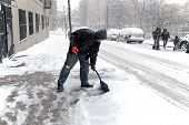 Man Shoveling During Snow Storm In New York