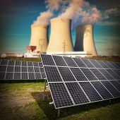 stock photo of sustainable development  - Solar panels against nuclear power plant - JPG