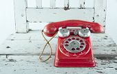 pic of toy phone  - Red toy telephone on light blue wooden vintage chair - JPG