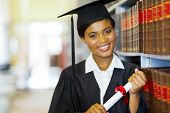 pretty female african college graduate in library