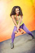 foto of zumba  - young woman at fitness exercise or zumba dancing - JPG