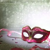 stock photo of mask  - Pink carnival mask with glittering background - JPG