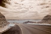 infrared photo of badlands and road in south dakota