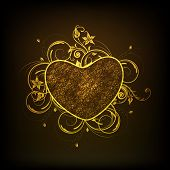Stylish golden floral decorated heart shape on shiny black background, Happy Valentines Day concept.