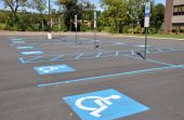 stock photo of physically handicapped  - several handicap parking areas in a parking lot - JPG