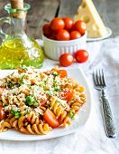 foto of whole-wheat  - Whole wheat Fusilli Pasta With Cheese And Cherry Tomatoes - JPG