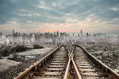 Railway tracks leading to big city