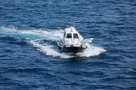 stock photo of messina  - PIlot boat in the Mediterranean Sea near the Straights of Messina - JPG