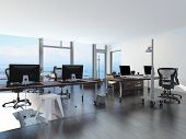 Modern waterfront office overlooking the sea with several computer workstations on movable wheeled o