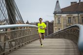 KRAKOW, POLAND - MAR 23, 2014: Unidentified participant during the annual Krakow international Marathon. Krakow Marathon conducted since 2002 under the slogan: With history in the background.