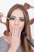closeup of beautiful blond girl getting makeup done