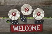 Red white and blue welcome sign