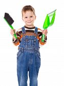 Little boy with brush and dustpan