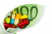 tablets and one hundred euro banknote symbolic photo: cost of medicine and drugs in the pharmaceutic