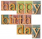 happy birthday - a collage of isolated letterpress wood type printing blocks