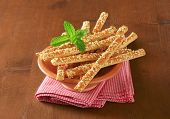 cheese sticks served in the bowl with fabric linen