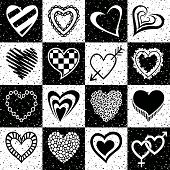 Hand drawn set of black and white hearts.