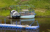 stock photo of pontoon boat  - The Old pontoon boat on river Volga - JPG