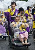 Elderly Japanese Festival Dancers in wheelchairs
