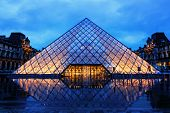 PARIS, FRANCE - June 29:  Musee Louvre pyramid on a rainy night, June 29, 2014.  The Louvre is one o