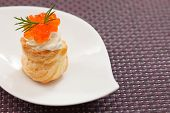 Puff pastry with cream cheese and caviar