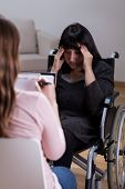 Woman On Wheelchair Talking With Therapist