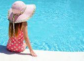 Young Girl Sat By The Pool