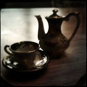 Instagram filtered image of a teacup and teapot