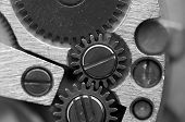 Black White Metallic Background With Metal Cogwheels A Clockwork. Macro